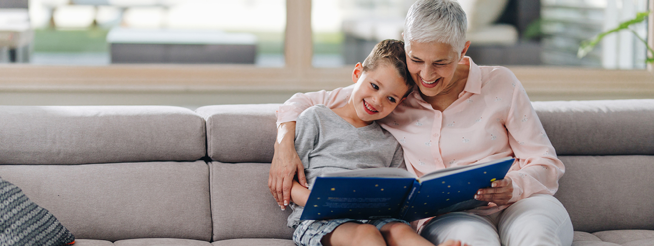 Grandmother reading to her grandson