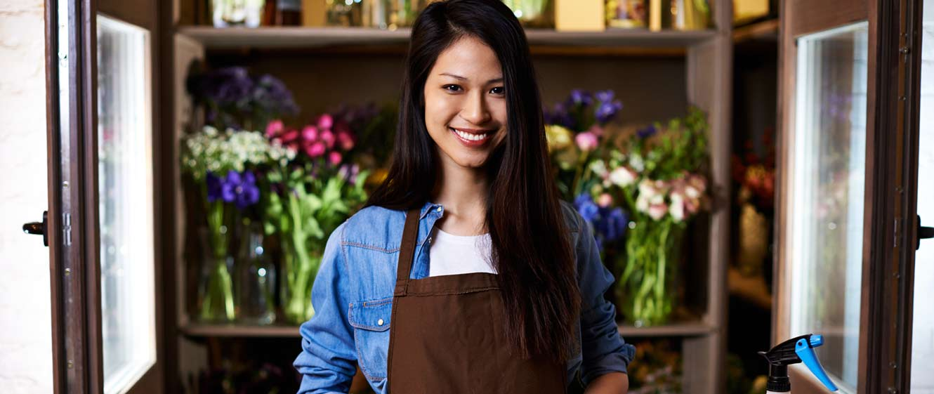 Image of small business owner woman in flower shop.
