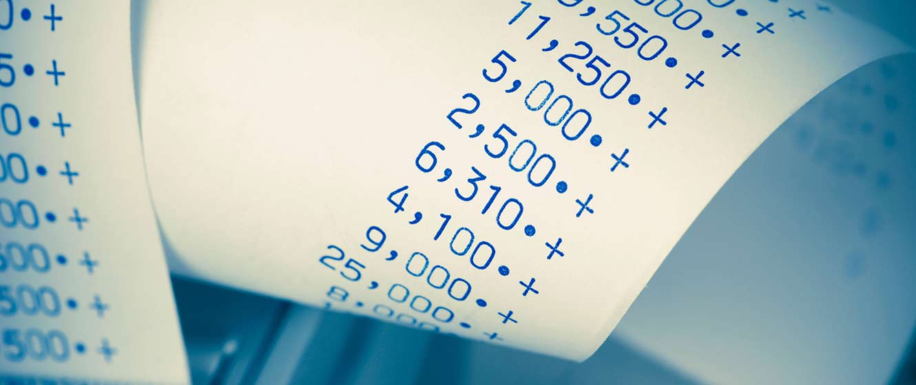 Image of payroll, adding machine paper roll with numbers