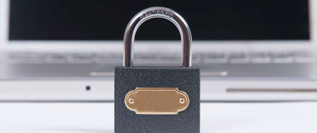 Image of lock sitting in front of laptop.