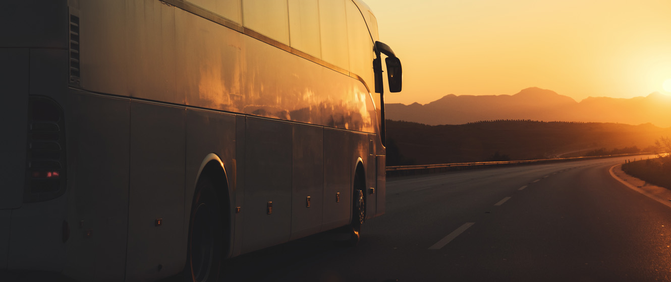 Motor coach traveling down the highway